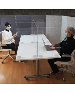 Clear Polycarbonate Table Divider on a White Table Creating Physical Separation